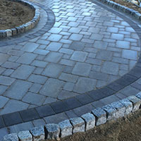 Hattoys installs curved stone paths